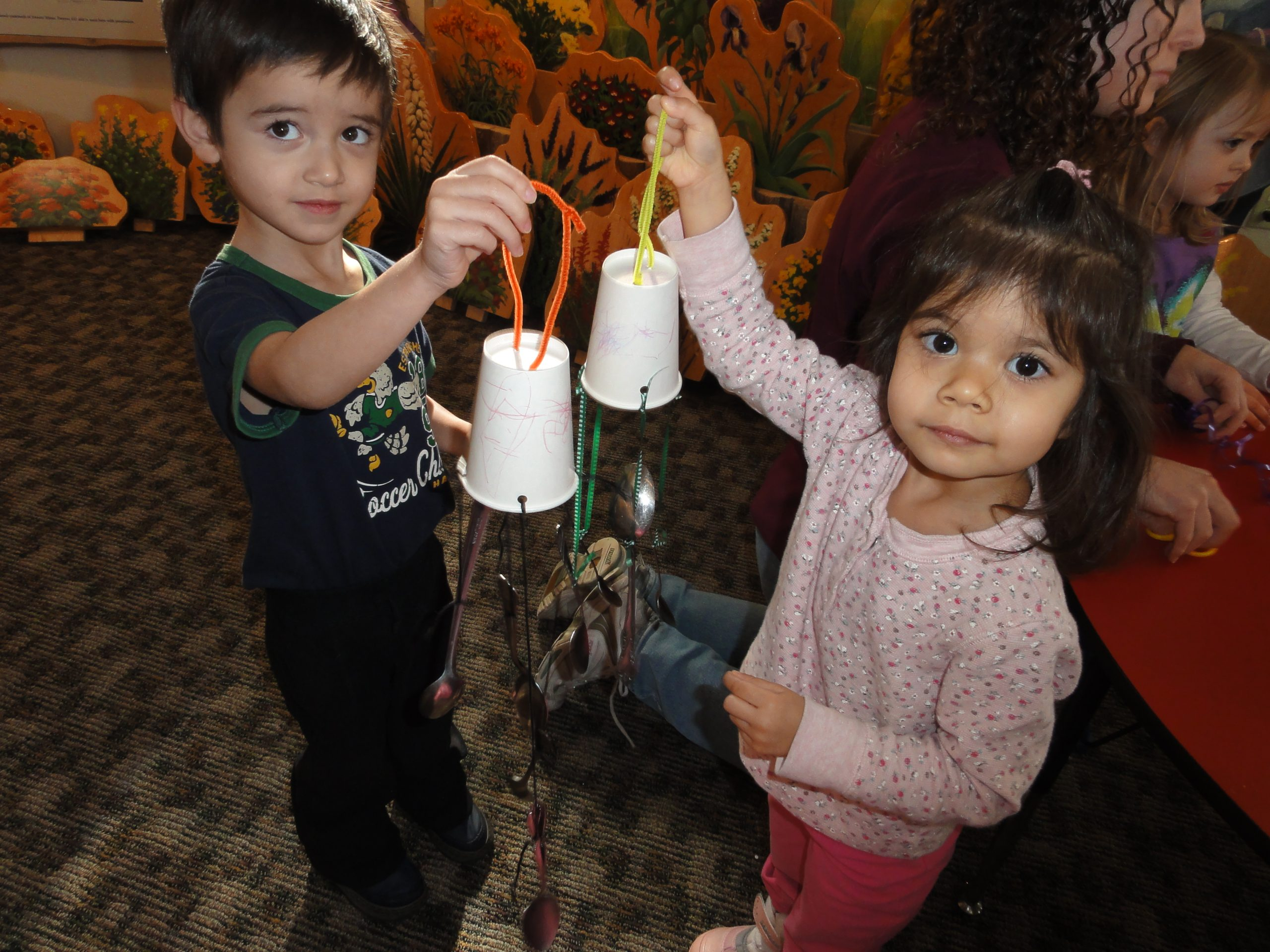 kids with nature wind chimes